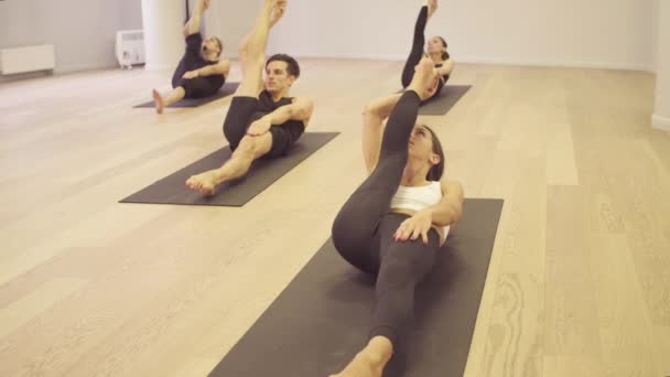Yoga class. Reclining hand-to-big-toe pose