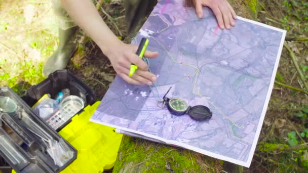 Female hands marking waypoints on the map