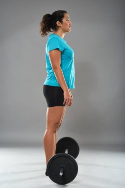 Fitness woman with heavy barbell