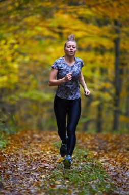 sport woman running in forest