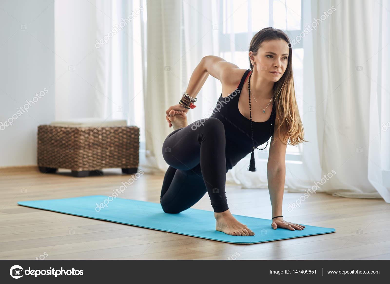 Yoga trainer in asana ⬇ Stock Photo, Image by © Xalanx #147409651