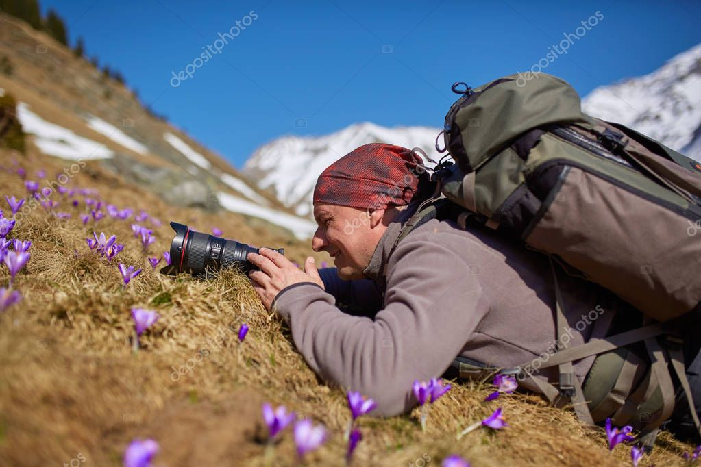 Hiker with camera taking photos