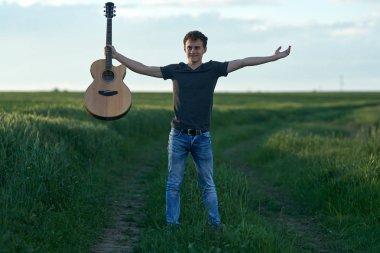 Teenage boy with guitar