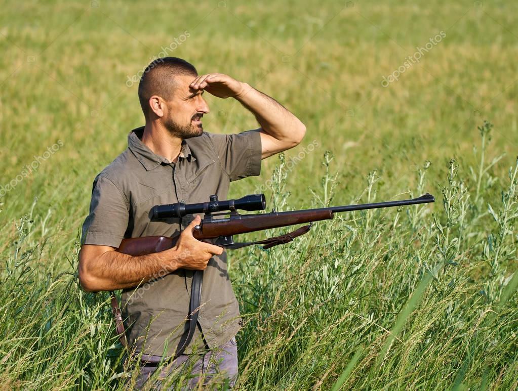 Wildlife gamekeeper with rifle