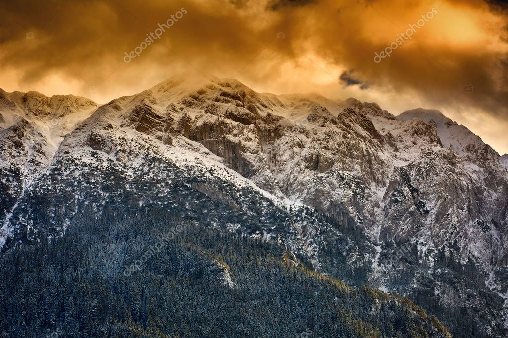 High mountains powdered with snow in the sunset light