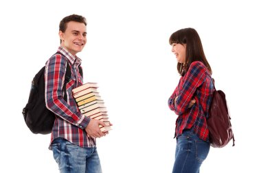 Unhappy teenager holding books while being made fun of stock vector