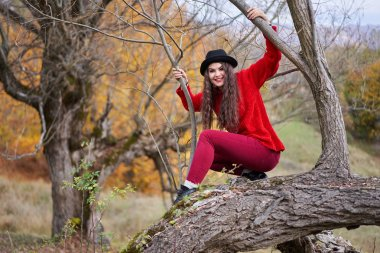 Portrait of a beautiful Hispanic young woman in an autumnal forest