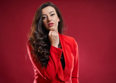Closeup of an attractive young businesswoman on red background