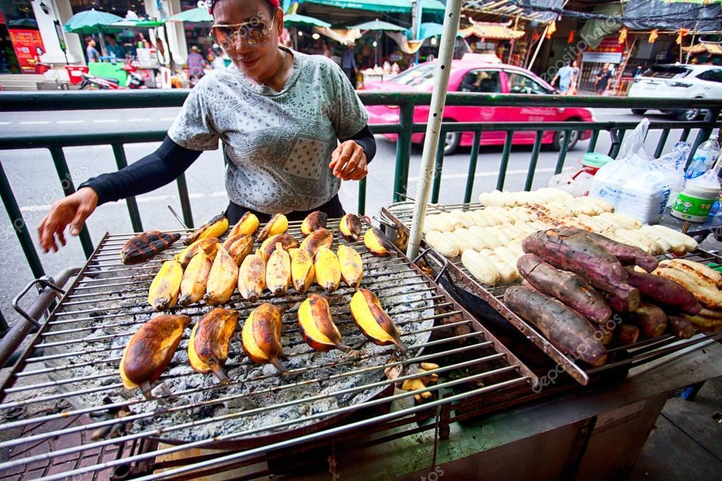 vendor prepare food at a street restaurant