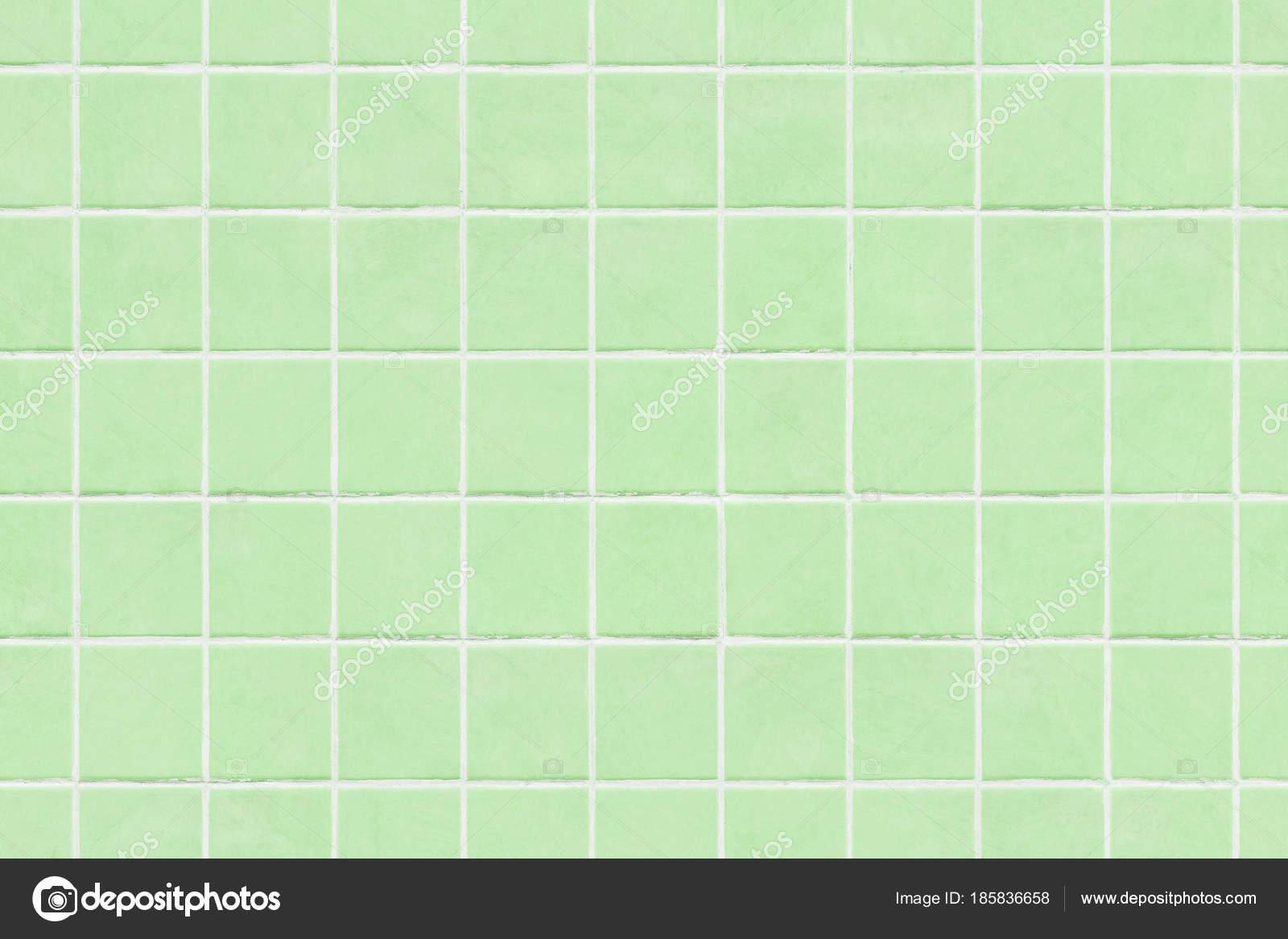 Fondo di struttura della parete di mattonelle verdi u foto stock
