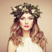 Fotografie Beautiful blonde woman with flower wreath on her head