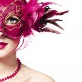 Fotografie krásná mladá žena v červené tajemné benátské masky