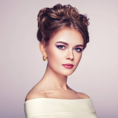 Brunette woman with elegant and shiny hairstyle