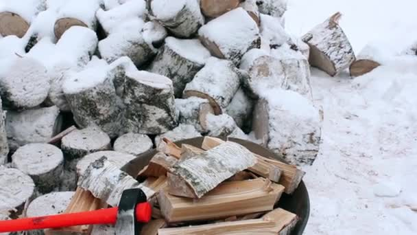 Firewood split and lie along with a cleaver