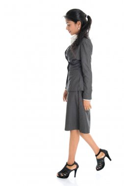 Side view Indian business woman walking