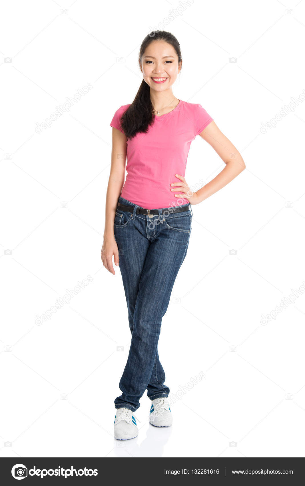 00856d7feed Portrait of young Asian woman in pink shirt and jeans with ponytail hair is  smiling