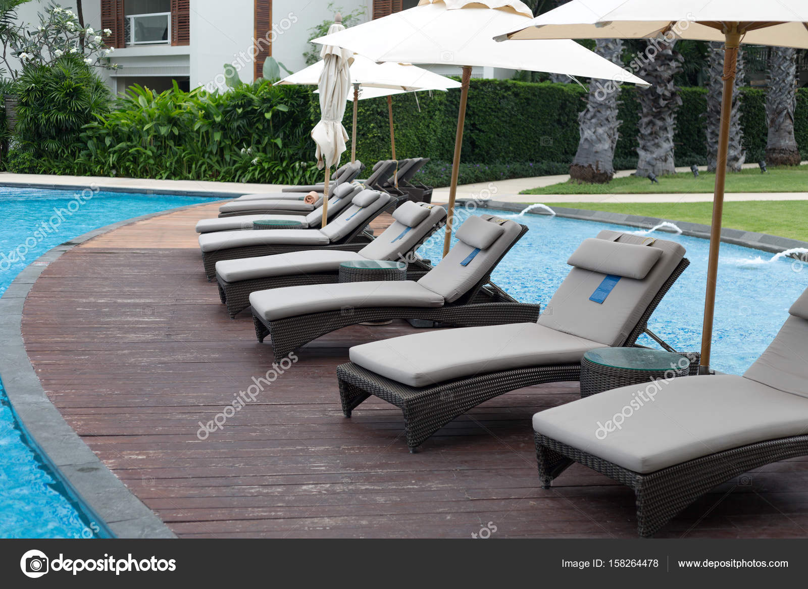 Swimming pool with sun shelters — Stock Photo © Ruslan #158264478