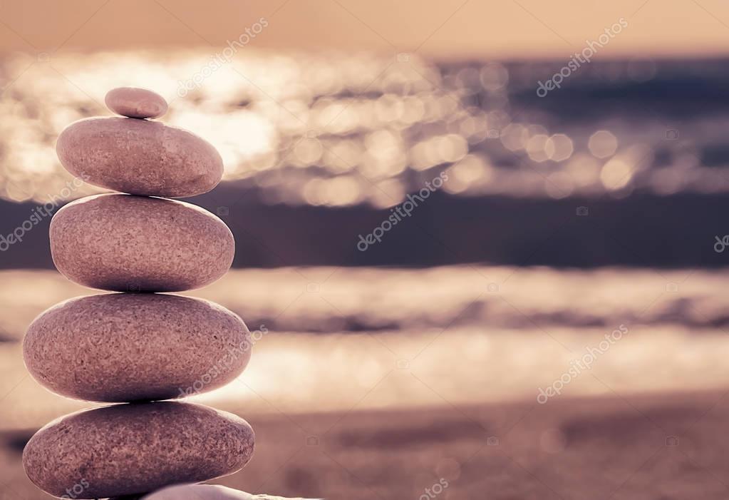 Vintage hipster style Zen meditation background, balanced stones