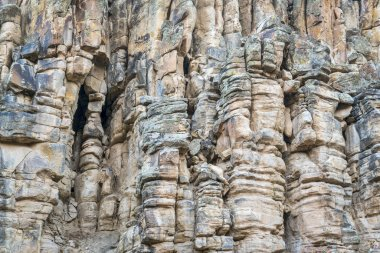 sandstone cliff with columns and pillars