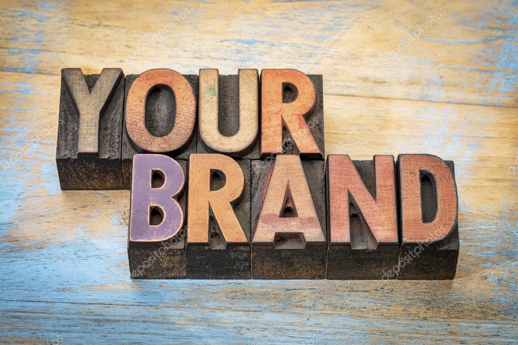your brand word abstract in wood type