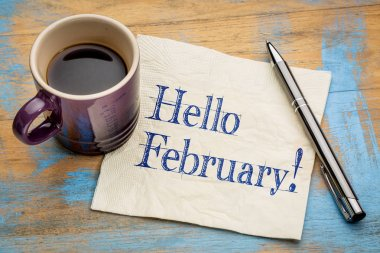 Hello February - handwriting on a napkin with a cup of coffee stock vector