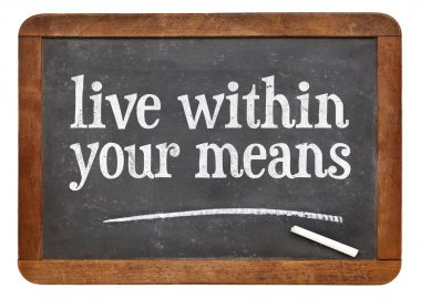 Live within your means blackboard sign