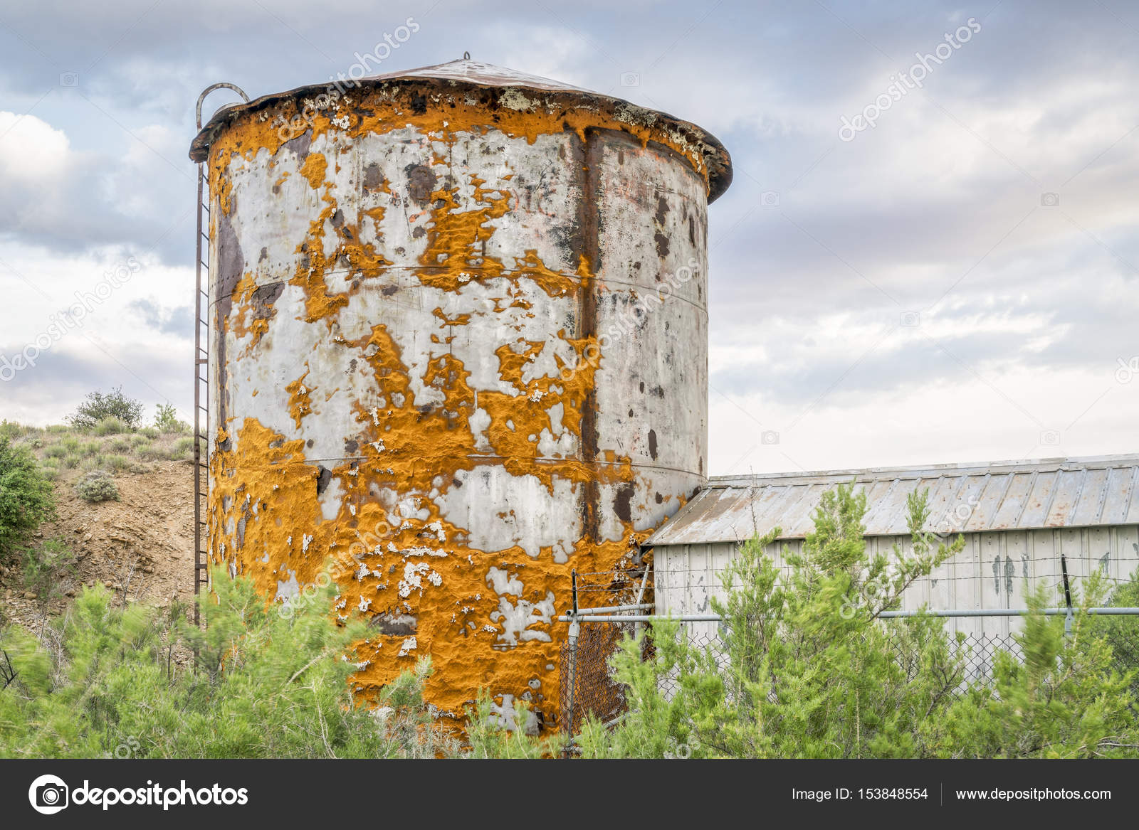Old water tank covered by lichen near Thompson Springs at Book Cliffs in eastern Utah u2014 Photo by PixelsAway & old water tank covered by lichen u2014 Stock Photo © PixelsAway #153848554