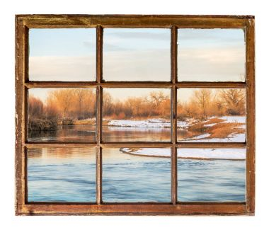 Small prairie river in winter scenery as seen through vintage, grunge, sash window with dirty glass stock vector