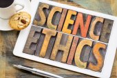 Fotografie science ethics word abstract on tablet