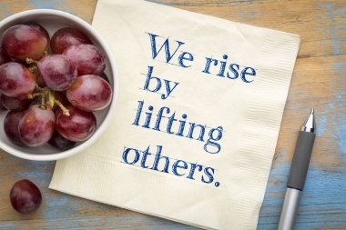 We rise by lifting others - wisdom quote on napkin