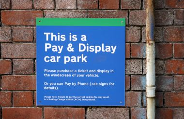 Cark park notice fastened to wall