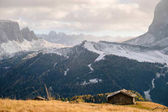 Photo Wooden cottage in dolomities alps Italy