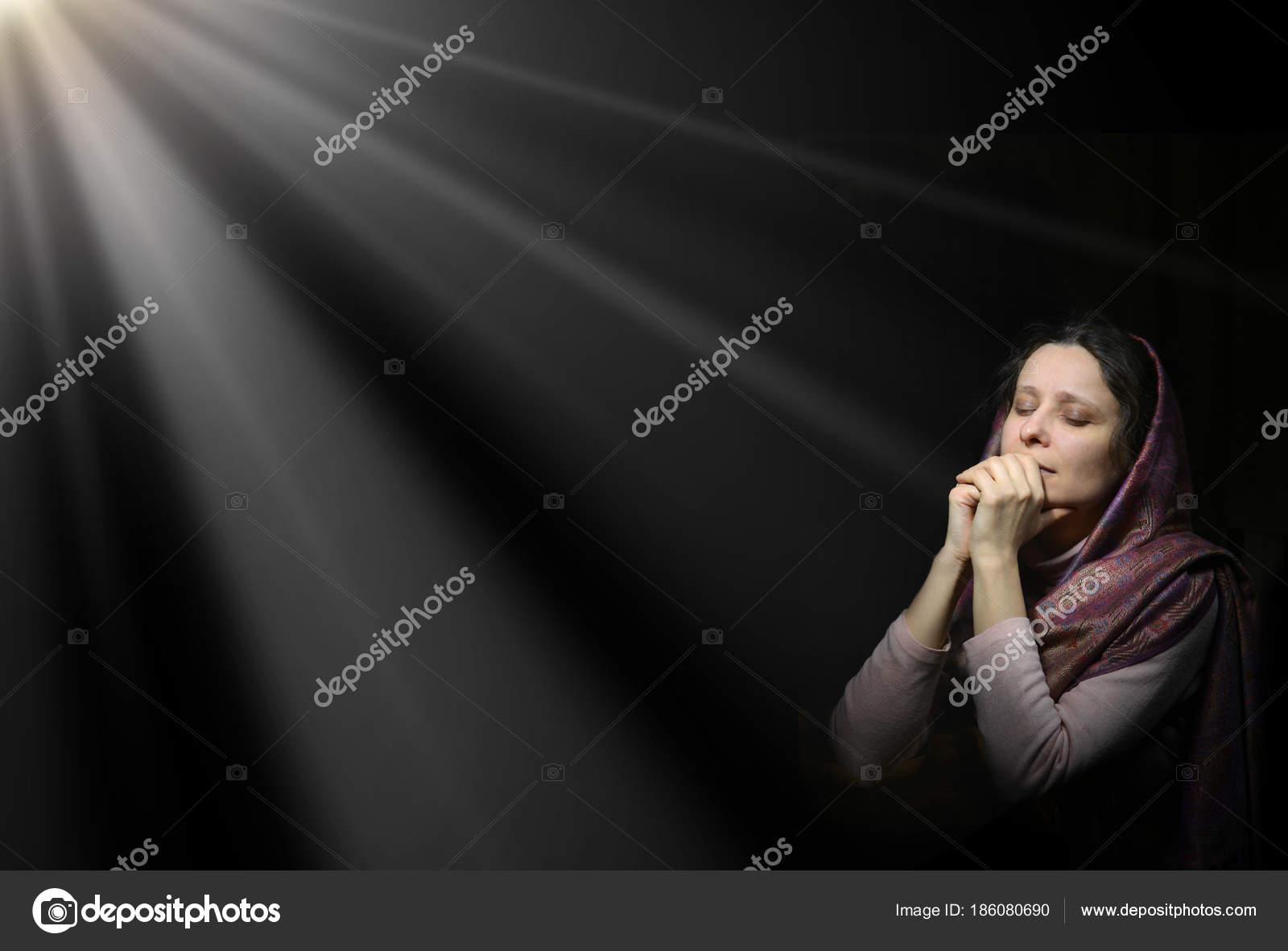 Praying woman in scarf — Stock Photo © Marinka #186080690