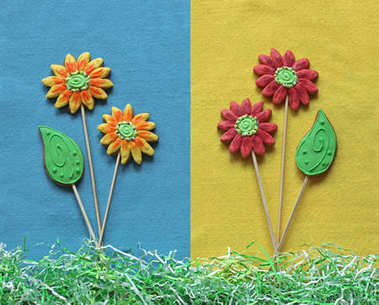 Gingerbread flowers and leafs on blue and yellow felt background. Punchy pastel minimalism concept.