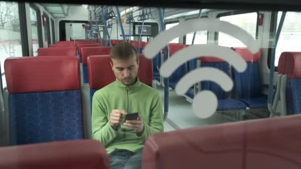 Handsome caucasian man using smartphone inside modern train, Wi-Fi sign on glass wall in the foreground. Accessible urban environment. People and gadgets in the city.