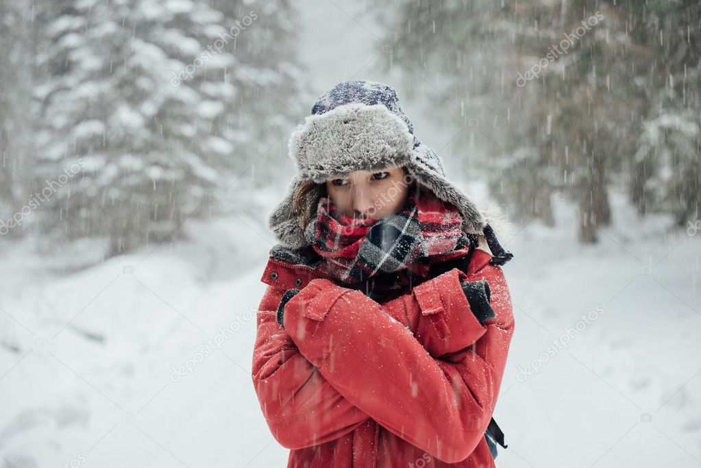 Winter portrait, young woman in winter forest