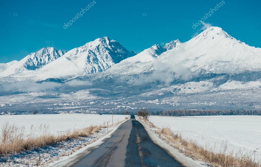 Road and snow covered mountains