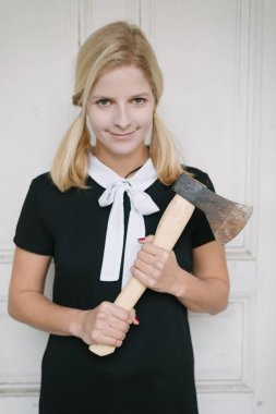 creepy blond woman with axe