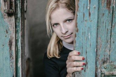 creepy blond woman  behind vintage