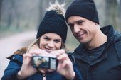 Fotografie Young couple taking self portrait outdoor