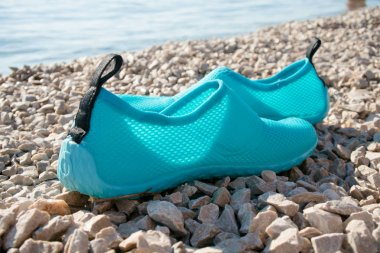 Swimming shoes on beach