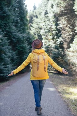 Free Happy Woman Enjoying Nature. Beauty Girl Outdoor. Freedom concept. Beauty Girl On forest path with backpack