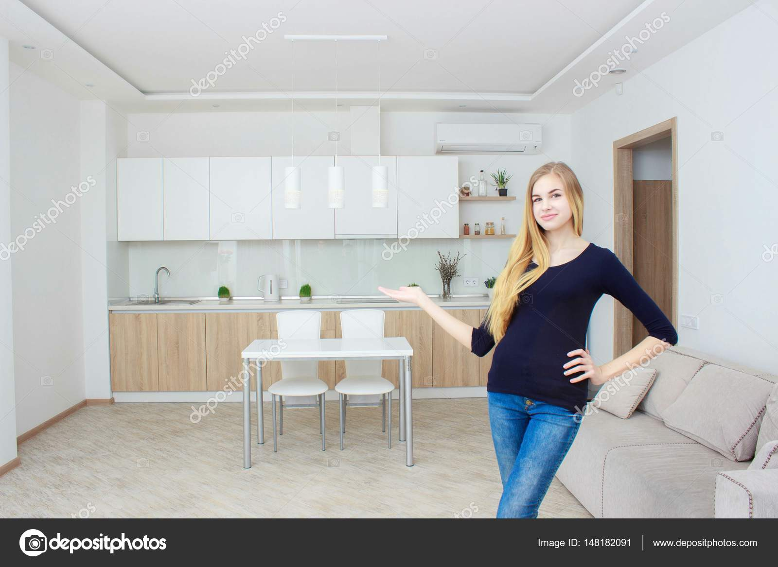 Real estate agent presenting modern house to client, woman Shows the ...