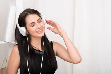 Young attractive woman listening to music with headphones