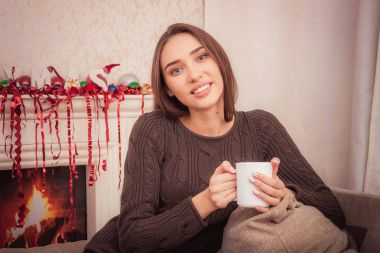 Beautiful woman at home drinking a coffee