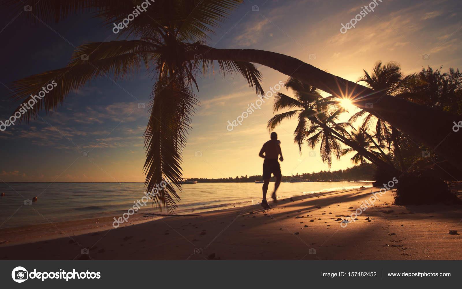 sea sunrise man running on the tropical island beach punta cana