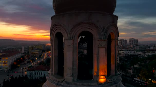 Aerial sunset view over The Cathedral of the Assumption in Varna, Bulgaria and street traffic in  city center