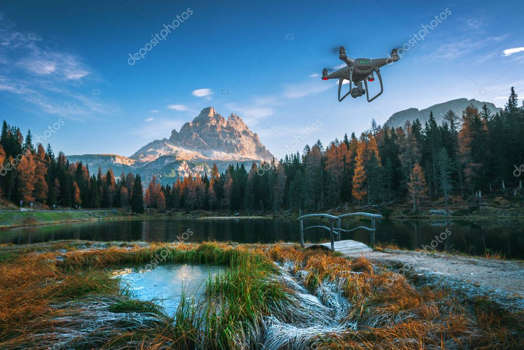 Lago Antorno Lake, Italy - Oct 20,2017: Flying drone quadcopter