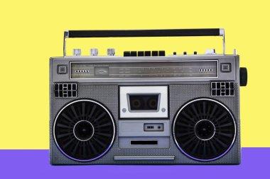 1980s Silver retro radio boom box on color background. Disco music