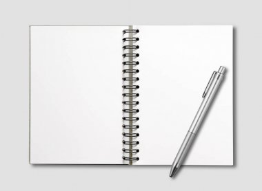 Blank open spiral notebook and pen isolated on grey